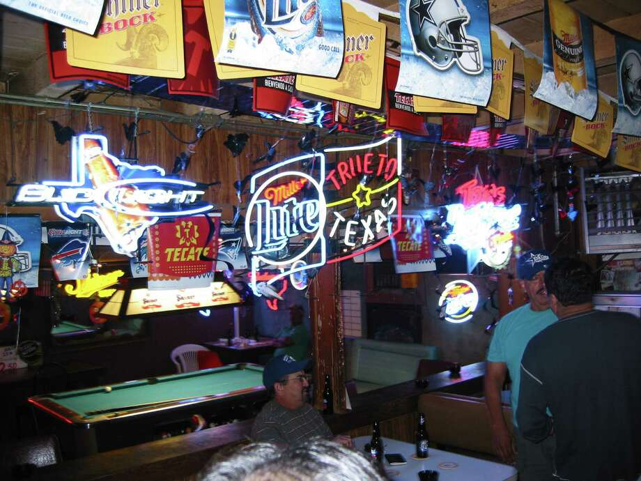 Neon is a major part of the décor at Texas Ice House on Blanco Road about three blocks south of Basse Road. Photo: RAMIRO BURR, SAN ANTONIO EXPRESS-NEWS / SAN ANTONIO EXPRESS-NEWS