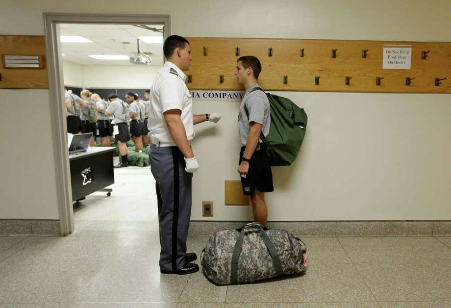 New cadet Sumner Ogrydziak, 17, of Nederland, Texas, listens to instructions during Reception Day at the U.S. Military Academy at West Point on Monday, July 1, 2013, in West Point, N.Y. He is entering the academy with his twin Cole and brother Noah, 19. If all three make it through the rigors of the next four years, no sure thing here, they will simultaneously toss their caps into the air as newly commissioned second lieutenants in the U.S. Army in 2017. Photo: Mike Groll, Associated Press / AP