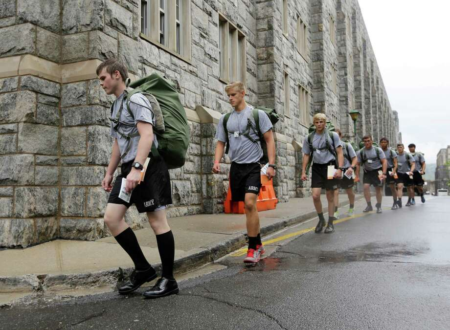 New cadet Cole Ogrydziak, 18, marches with other cadets during Reception Day at the U.S. Military Academy at West Point on Monday, July 1, 2013, in West Point, N.Y. He is entering the academy with his twin brother Sumner, and brother Noah, 19. Photo: Mike Groll, Associated Press / AP