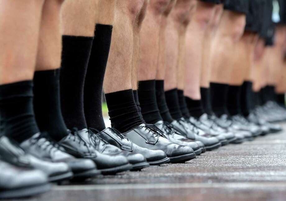 New cadets break in dress shoes while learning to march during Reception Day at the U.S. Military Academy at West Point on Monday, July 1, 2013, in West Point, N.Y. The academy welcomed about 1,200 members of the Class of 2017 for cadet basic training. Photo: Mike Groll, Associated Press / AP