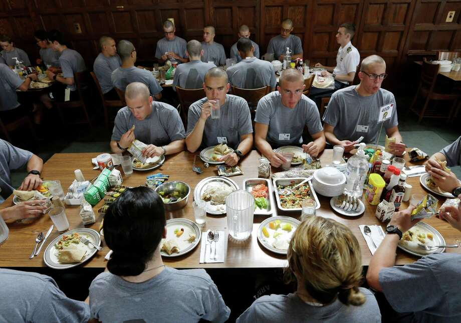 New cadets eat their first meal in the mess hall during Reception Day at the U.S. Military Academy at West Point on Monday, July 1, 2013, in West Point, N.Y. The academy welcomed about 1,200 members of the Class of 2017 for cadet basic training. Photo: Mike Groll, Associated Press / AP