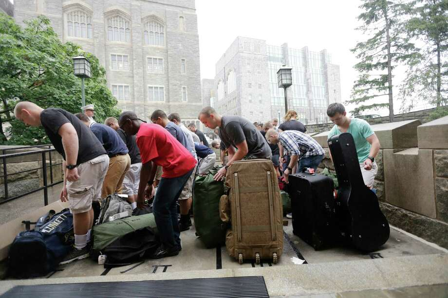 Cadet candidates gather their belongings during Reception Day at the U.S. Military Academy at West Point on Monday, July 1, 2013, in West Point, N.Y. The academy welcomed about 1,200 members of the Class of 2017 for cadet basic training. Photo: Mike Groll, Associated Press / AP