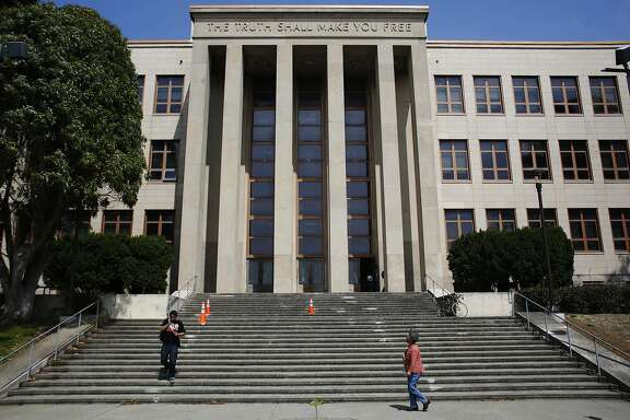 Students walk down the steps of a building at the City College of San Francisco which lost its accreditation effective on July 31, 2014 in San Francisco, Calif. on July 3, 2013