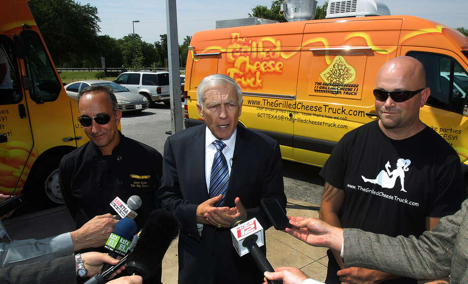Retired Gen. Wesley Clark (center) talked about the start of a program to hire veterans as franchisees of the Los Angeles-based Grilled Cheese Truck. His office will help connect the food trucks with veterans across the nation. With Clark are Grilled Cheese Truck founder Dave Danhi (left) and Vernon Gibson, the first veteran candidate for a franchise. Photo: Photos By John Davenport / San Antonio Express-News