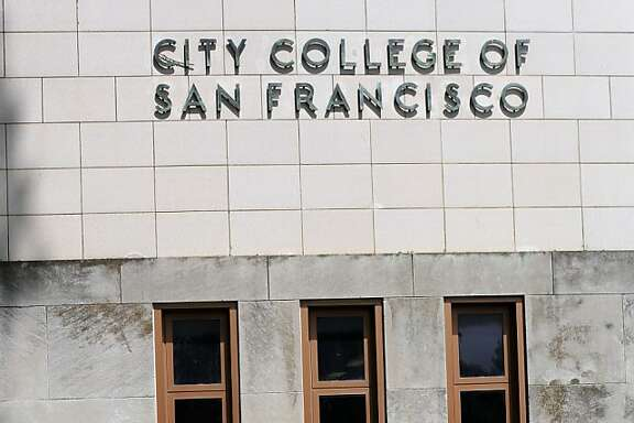 Claudeen Narnac walks down the steps in front of a City College of San Francisco sign in San Francisco, Calif. on July 3, 2013