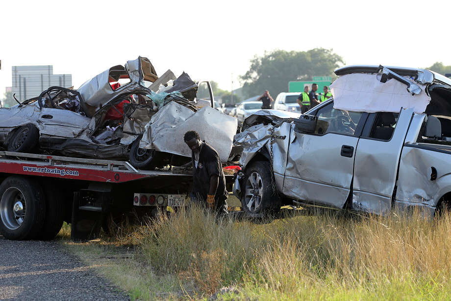 A westbound passenger car crossed the median and slammed into an eastbound pickup on Interstate 10 near Trainer Hale Road on July 3, 2013. Photo: Tom Reel/Express-News