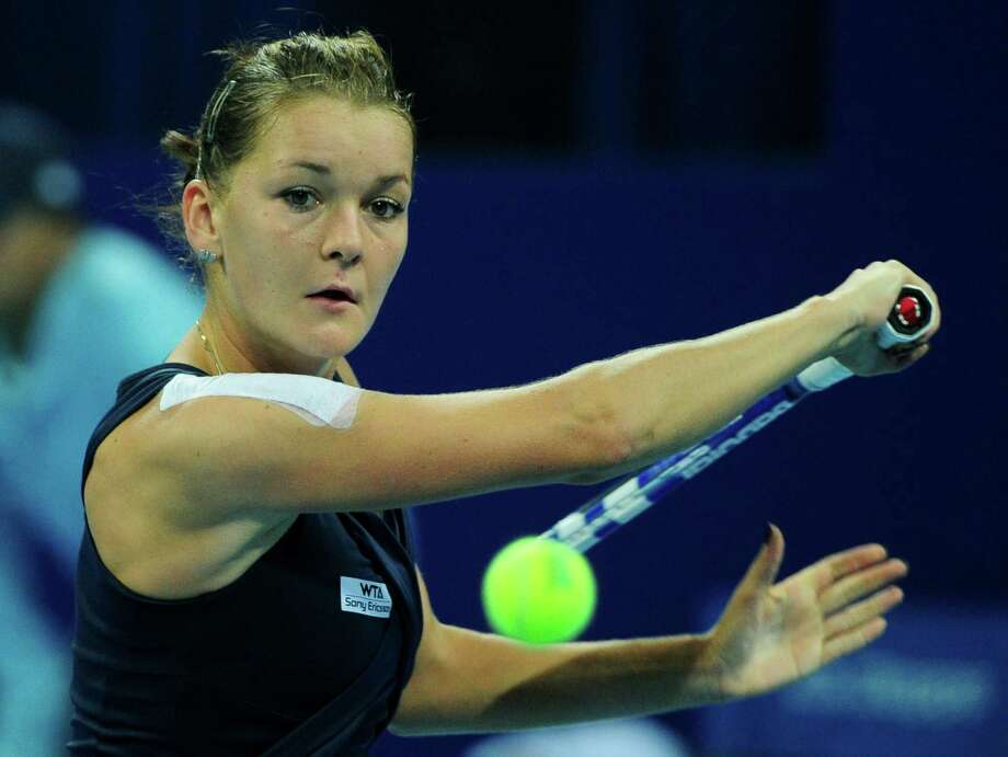 Agnieszka Radwanska of Poland returns a shot against Flavia Pennetta of Italy during their semi-final match in the China Open tennis tournament at the National Tennis Center in Beijing on October 8, 2011.  Radwanska won 6-2, 6-4.      AFP PHOTO/Mark RALSTON (Photo credit should read MARK RALSTON/AFP/Getty Images) Photo: MARK RALSTON, Staff / AFP