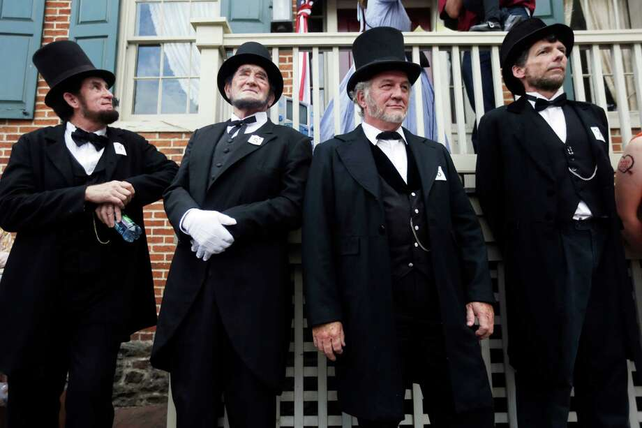 Impersonators take part in an Abraham Lincoln look alike contest during ongoing activities commemorating the 150th anniversary of the Battle of Gettysburg, Wednesday, July 3, 2013, in Gettysburg, Pa.  Union forces turned away a Confederate advance in the pivotal battle of the Civil War fought July 1-3, 1863, which was also the war's bloodiest conflict with more than 51,000 casualties. Photo: Matt Rourke, Associated Press / AP