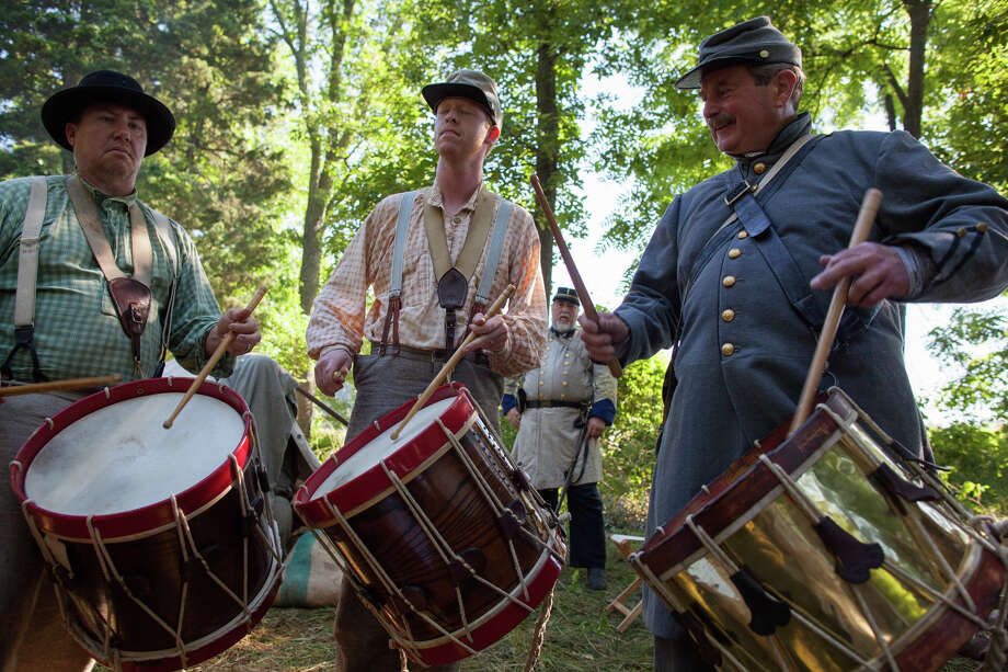 From left, Tommy White, Noah Raper and Jim Smith play drums during the 150th anniversary of the Battle of Gettysburg, Saturday, June 29, 2013, at Bushey Farm in Gettysburg, Pa. The Union Army stopped a major Confederate advance during a battle fought July 1-3, 1863, often considered the war's major turning point. Photo: Zach Gibson, Associated Press / Richmond Times-Dispatch