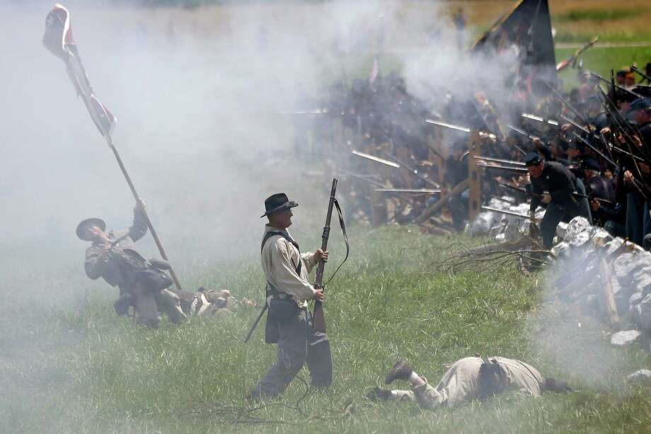 Re-enactors portray Pickett's Charge during ongoing activities commemorating the 150th anniversary of the Battle of Gettysburg, Sunday, June 30, 2013, at Bushey Farm in Gettysburg, Pa. Photo: Matt Rourke, Associated Press / AP