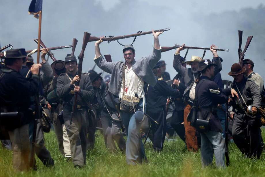 Re-enactors demonstrate Pickett's Charge during ongoing activities commemorating the 150th anniversary of the Battle of Gettysburg, Sunday, June 30, 2013, at Bushey Farm in Gettysburg, Pa. Photo: Matt Rourke, Associated Press / AP