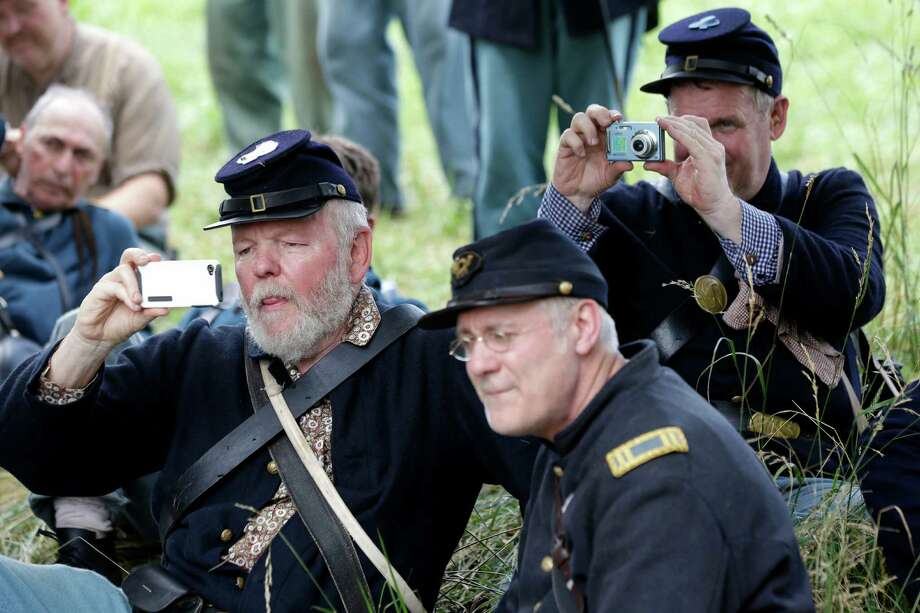 Re-enactors snap photos before a demonstration of Pickett's Charge during ongoing activities commemorating the 150th anniversary of the Battle of Gettysburg, Sunday, June 30, 2013, at Bushey Farm in Gettysburg, Pa. Photo: Matt Rourke, Associated Press / AP