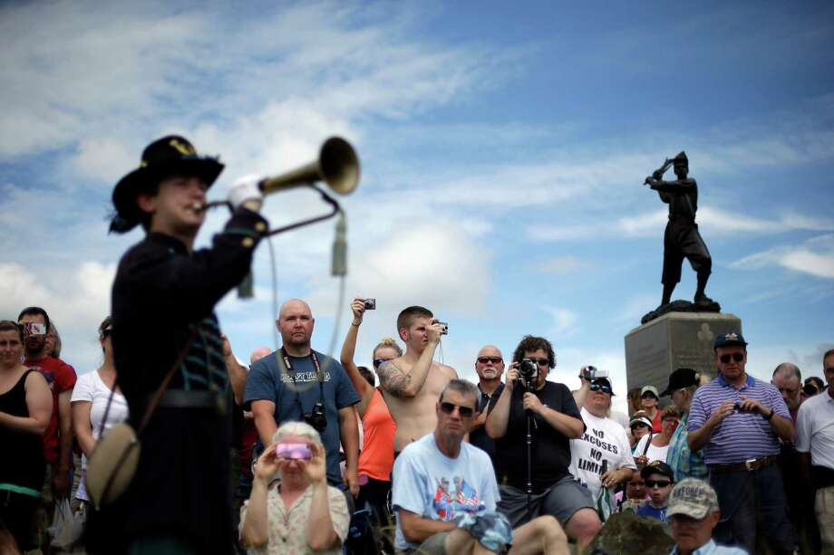 Alan Tolbert, 15, of Shippensburg Pa., plays Taps at Gettysburg National Military Park at the end of a commemorative march where Pickett's Charge took place during ongoing activities commemorating the 150th anniversary of the Battle of Gettysburg, Wednesday, July 3, 2013, in Gettysburg, Pa. Photo: Matt Rourke, Associated Press / AP