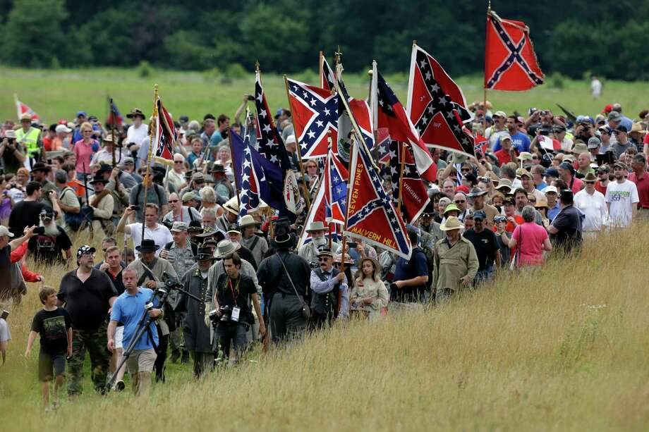 Visitors to Gettysburg National Military Park take part in a commemorative march where Pickett's Charge took place during ongoing activities commemorating the 150th anniversary of the Battle of Gettysburg, Wednesday, July 3, 2013, in Gettysburg, Pa. Photo: Matt Rourke, Associated Press / AP