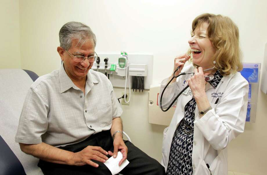 Dr. Martha Mims tries to connect with the patients, like Ibnul Hasan Rizvi, she sees at Harris Health System's Smith  Clinic. Photo: Melissa Phillip, Staff / © 2013  Houston Chronicle
