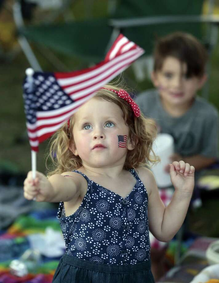 Ashtyn Wages, 4, of Dallas waves her flag during the Kaboom Town Fourth of July celebration on Wednesday, July 3, 2013, at Addison Circle Park in Addison, Texas. Photo: Michael Ainsworth, Associated Press / The Dallas Morning News