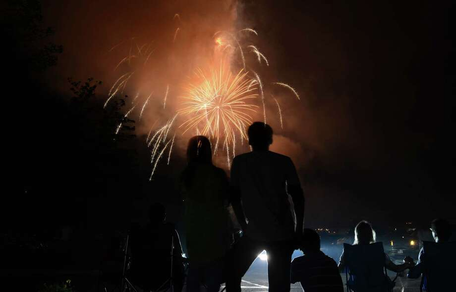 Fans watch the fireworks show at the Danbury Fair in Danbury, Conn. on Wednesday, July 3, 2013.  The mall offered live music, food and kids games, concluded by the fireworks display at 9:30. Photo: Tyler Sizemore / The News-Times