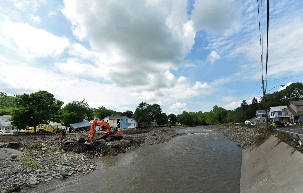 An earth mover works on the banks of the Otsquago Creek Wednesday July 3, 2013, in Fort Plain, N.Y. (Skip Dickstein/Times Union)