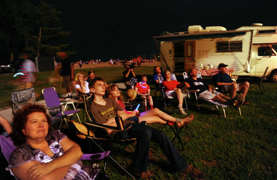 Spectators watch the fireworks display at Short Beach in Stratford, Conn. on Wednesday July 3, 2013. Photo: Christian Abraham / Connecticut Post
