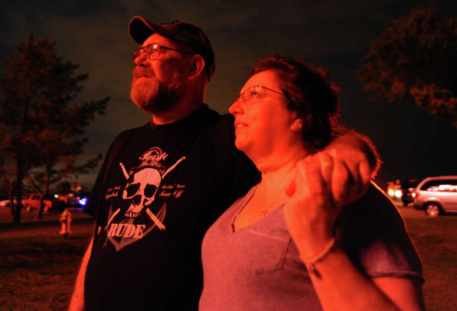 Spectators Albert Walter Arnold Jr., of Norwalk, and his girlfriend M.J. Ligouri, of Bridgeport, watch the fireworks display at Short Beach in Stratford, Conn. on Wednesday July 3, 2013. Photo: Christian Abraham / Connecticut Post