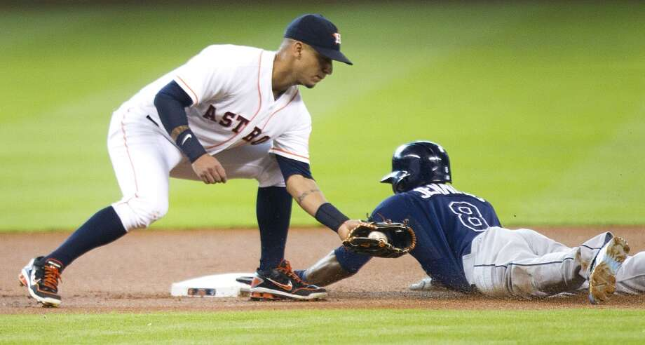 Astros shortstop Ronny Cedeno brings a late tag down on Desmond Jennings as he steals second.