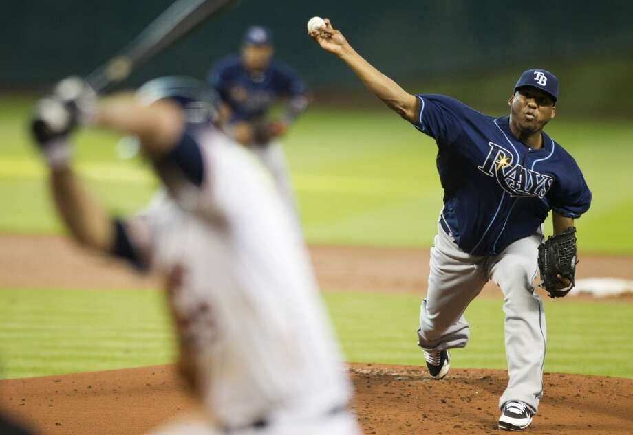 Rays starting pitcher Roberto Hernandez releases a pitch to Astros first baseman Brett Wallace.
