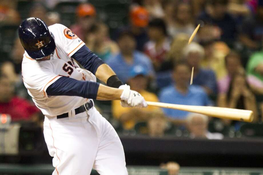 Astros left fielder J.D. Martinez breaks his bat on a fly out to left.