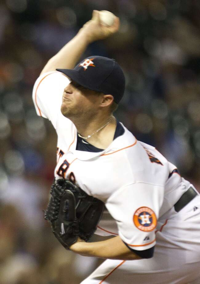 Astros starting pitcher Bud Norris releases a pitch.