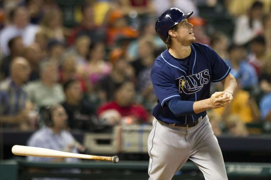 Rays right fielder Wil Myers tosses his bat as he flies out to center field.