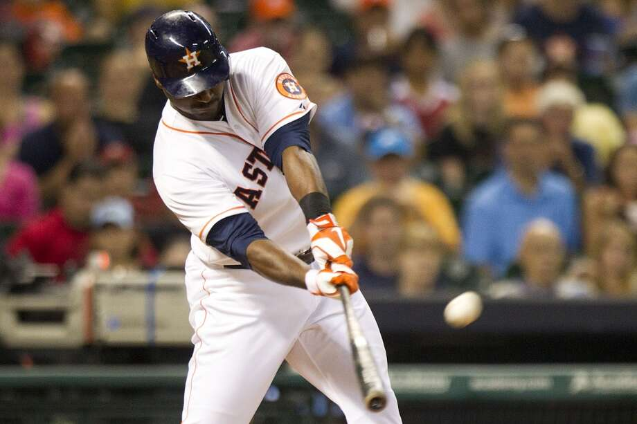Astros left fielder Chris Carter hits a three-run home run off Rays relief pitcher Jake McGee.