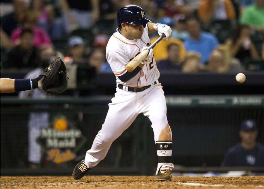 Astros second baseman Jose Altuve lays down a sacrifice bunt.