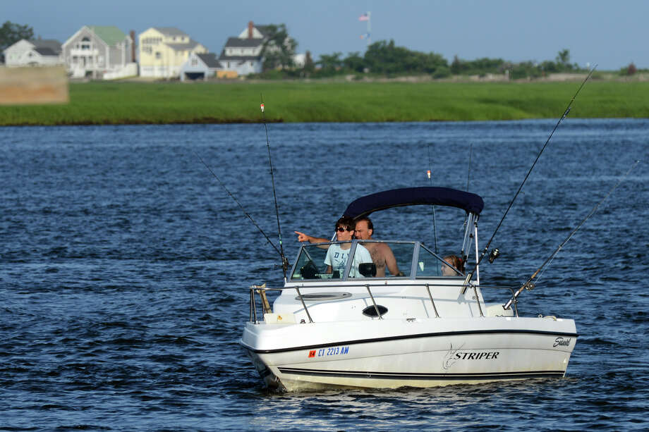 A boat makes its way along the entrance to the Housatonic River in Stratford, Conn. on Wednesday July 3, 2013. Photo: Christian Abraham / Connecticut Post