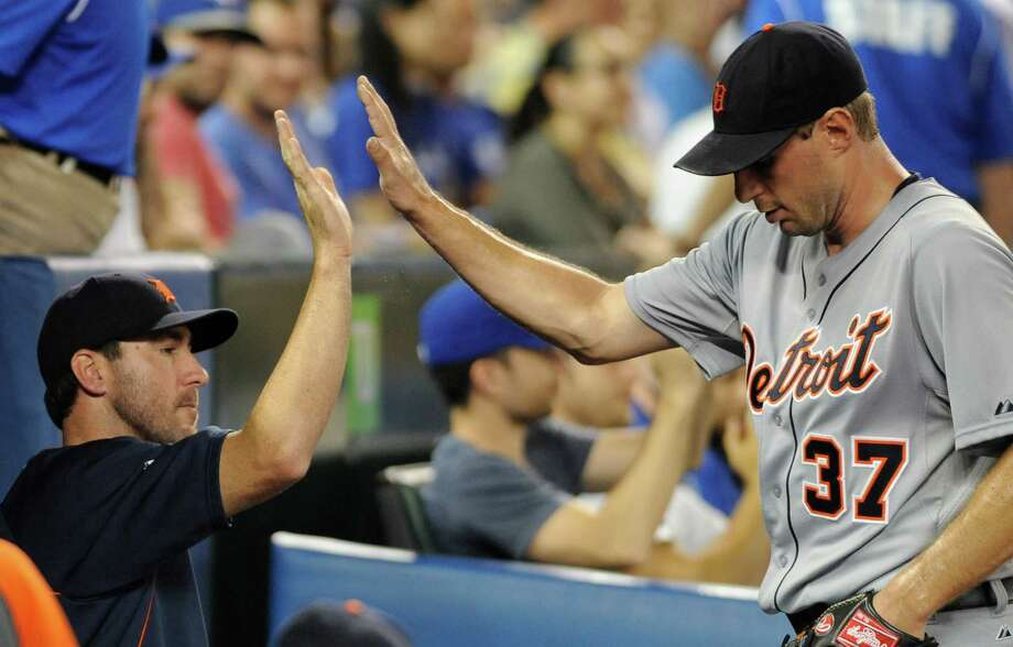 TORONTO, CANADA - JULY 3:  Max Scherzer #37 of the Detroit Tigers high-fives teammate Justin Verlander #35 after being pulled in the seventh inning during MLB game action against the Toronto Blue Jays July 3, 2013 at Rogers Centre in Toronto, Ontario, Canada. (Photo by Brad White/Getty Images) ORG XMIT: 163494393 Photo: Brad White / 2013 Getty Images