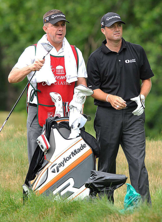 New Orleans Saints coach Sean Payton, left, traded his vacation for a week of caddying for his friend, PGA Tour pro Ryan Palmer. Photo: Rick Barbero, MBO / The Register-Herald