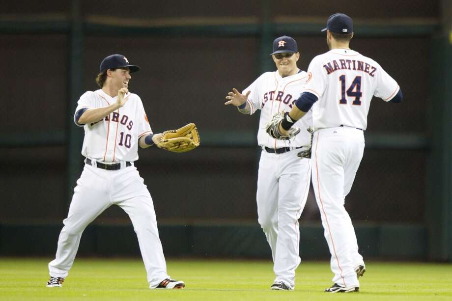 Astros outfielders baseman Jake Elmore,  Brandon Barnes and J.D. Martinez celebrate the Astros win over the Rays.