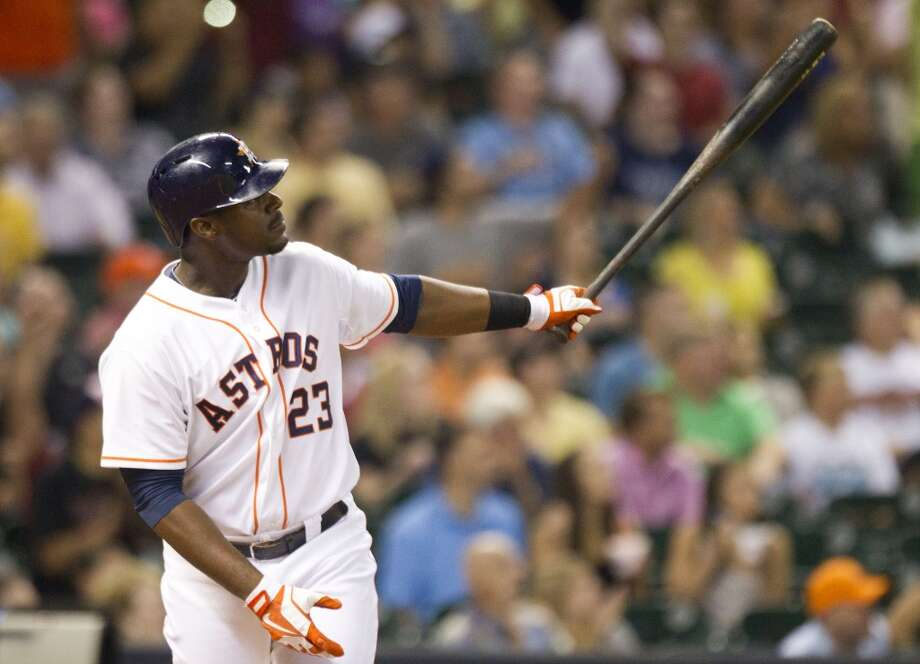 Astros left fielder Chris Carter watches the flight of his 3-run home run.