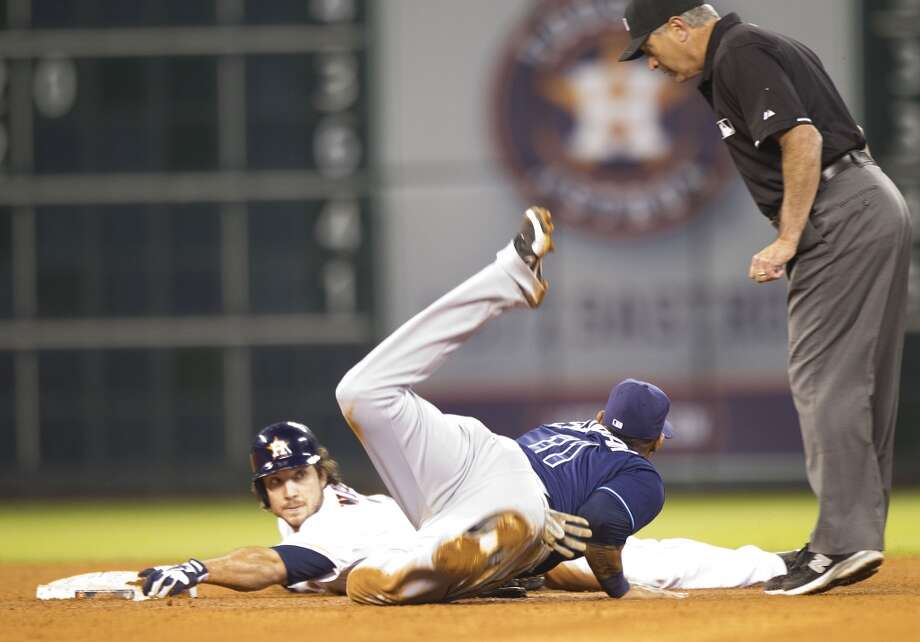 Astros first baseman Brett Wallace slides safely under Rays shortstop Yunel Escobar with a double to left during the seventh inning.