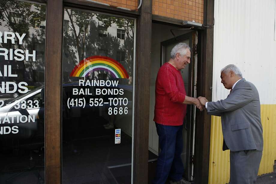 Longtime bail bondsman Jerry Barrish (left) is greeted by well-wisher Daro Inouye as he closes his S.F. business of 52 years. Photo: Katie Meek, The Chronicle