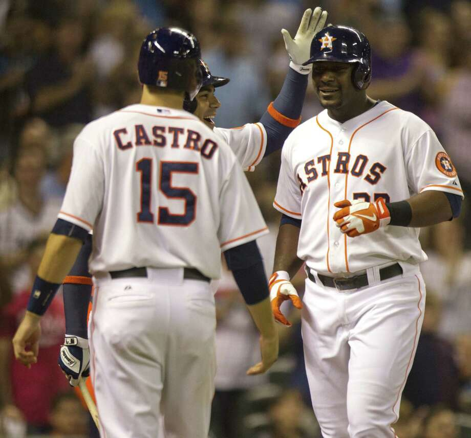 The Astros' Chris Carter (right) is greeted by Jason Castro and Carlos Peña after his second homer. Photo: Brett Coomer / Houston Chronicle