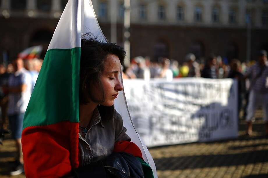 A woman attends an anti-government protest in Sofia on July 3, 2013. Thousands of Bulgarians, sick of a political class they see as too dependent on shadowy oligarchs, have taken to the streets every day since June 14, just four months after anti-poverty and corruption rallies ousted the previous conservative cabinet. AFP PHOTO / DIMITAR DILKOFFDIMITAR DILKOFF/AFP/Getty Images Photo: Dimitar Dilkoff, AFP/Getty Images