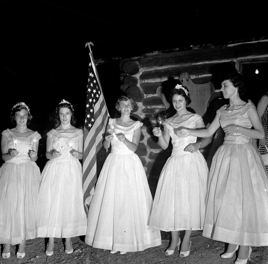 circa 1955:  The Queen of Candles and her maids light sparklers before leading the coronation procession, part of the celebrations for the fourth of July, American Independence Day. Photo: Evans/Three Lions, Getty Images / Hulton Archive