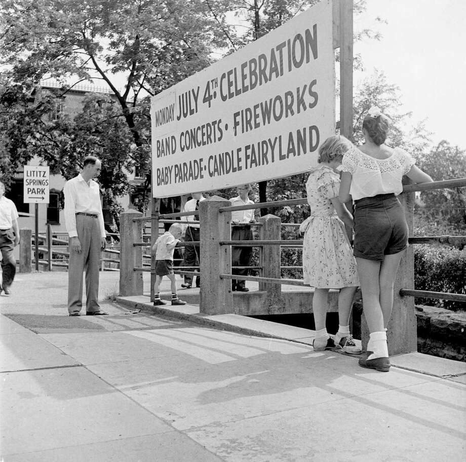 circa 1955:  A sign outside Lititz Springs Park, Pennsylvania, advertises the events organised for the fourth of July, American Independence Day. These include a display of candles floating on the pond, and a parade of children commemorating the events of the American Civil War. Photo: Evans/Three Lions, Getty Images / Hulton Archive