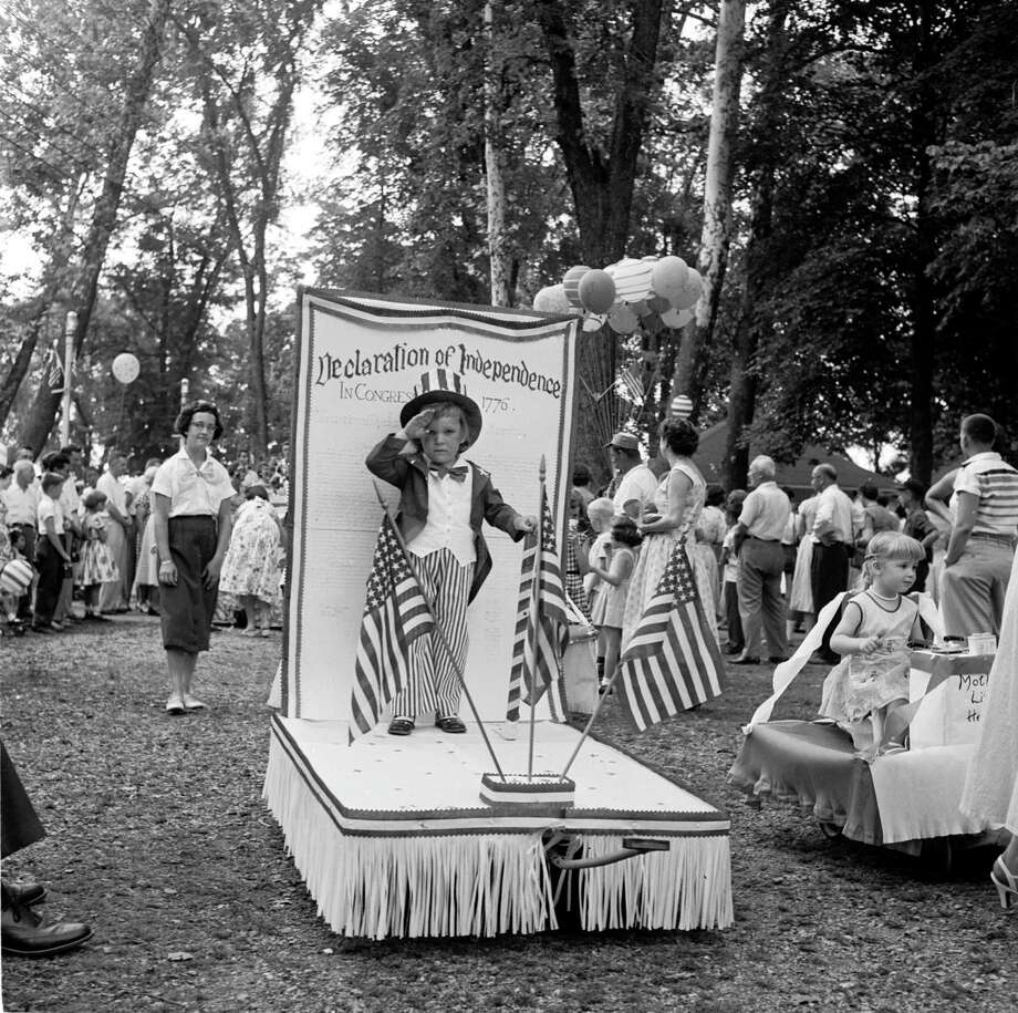 circa 1955:  A young boy on a miniature float commemorates the American Declaration of Independence, at the baby parade in Lititz park, Pennsylvania. The children are judged on their appeal and costume, as part of the Independence Day celebrations on the 4th of July. Photo: Evans/Three Lions, Getty Images / Hulton Archive