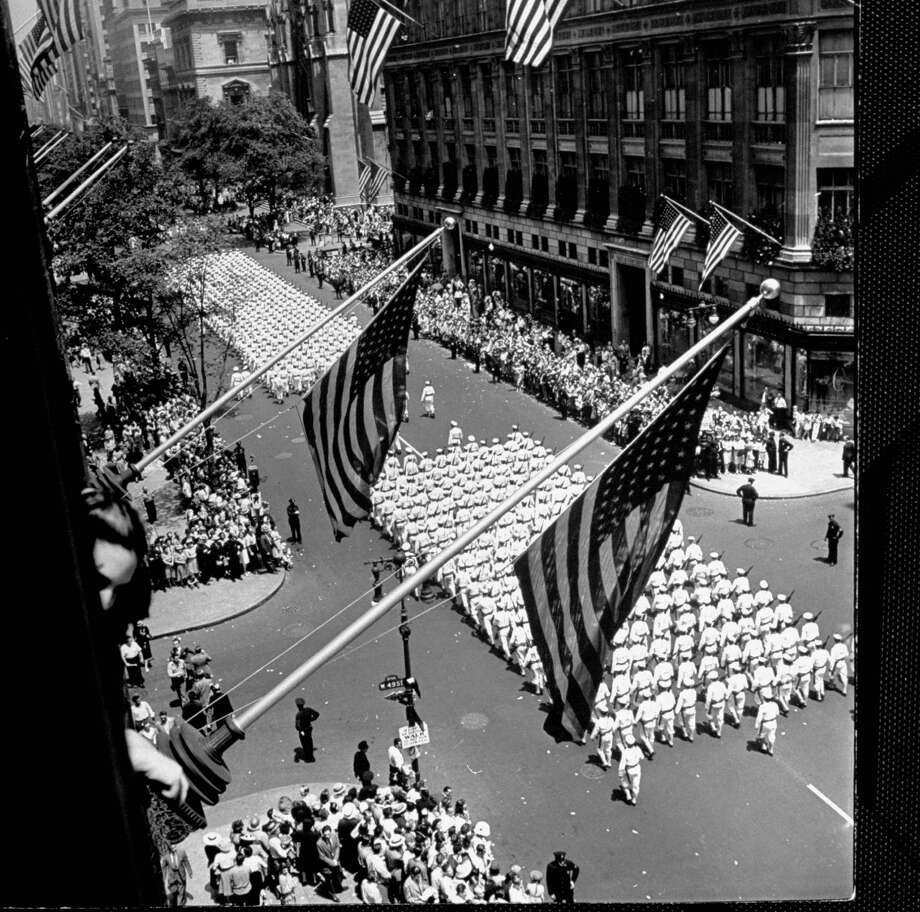 Columns of U.S. Coast Guard marching in Independence Day parade up Fifth Avenue past Saks Fifth Avenue dept. store between 49th & 50th Streets in 1942. Photo: Andreas Feininger, Time & Life Pictures/Getty Image / Time Life Pictures