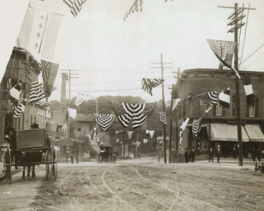 A street decorated for Independence Day in a small American town, circa 1910.