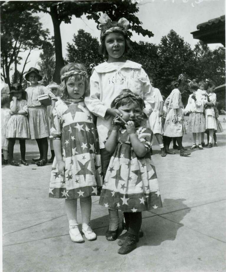 A trio of young girls pose for a portrait during a July 4th celebration, Avondale, Ohio, 1918. Photo: Felix Koch/Cincinnati Museum Center, Getty Images / Archive Photos