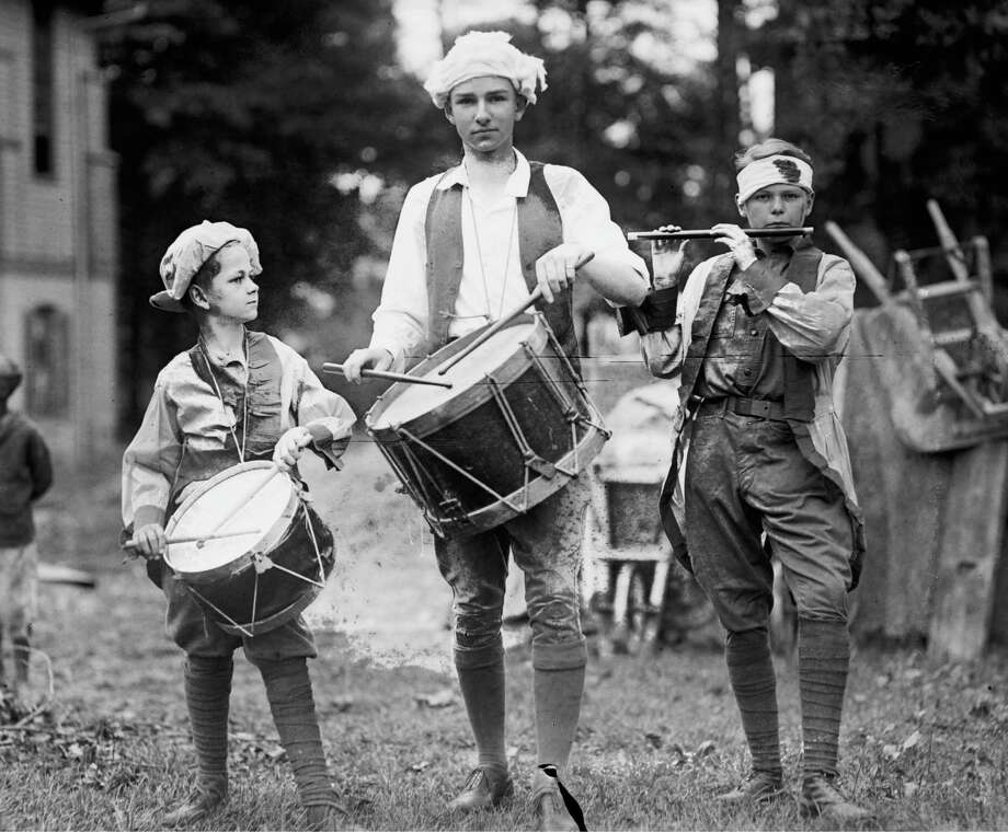 Circa 1922: Three Boys March with Instruments on the 4th of July Celebration; Dressed in colonial garb as the Spirit of 76. Photo: Library Of Congress, Buyenlarge, Getty Images / Archive Photos