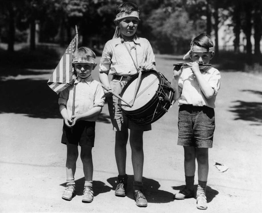 Three boys dressed as a patriotic band to celebrate Independence Day on July 4th, circa 1940. Photo: Bert Garai/Keystone View/Hulton Archive, Getty Images / 2008 Getty Images