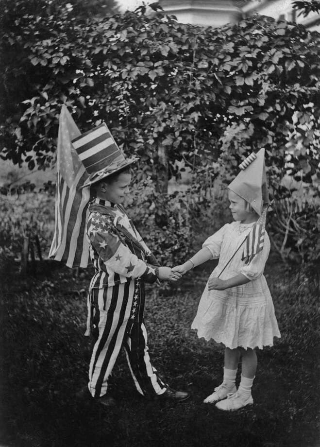 A boy and a girl in patriotic fourth of July costumes, shake hands, circa 1925. Photo: Paul Thompson/FPG/Archive Photos, Getty Images / 2011 Getty Images