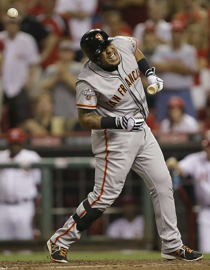 Hector Sanchez is hit by a pitch in the eighth, when the Giants left the bases loaded. Photo: Al Behrman, Associated Press
